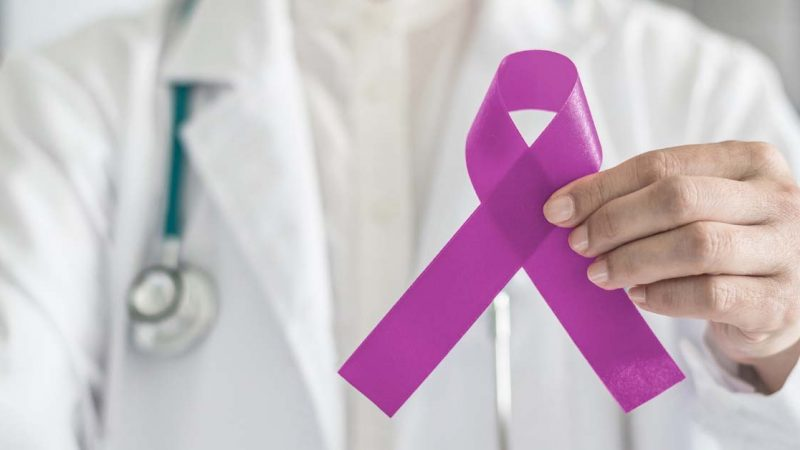 Doctor-holding-breast-cancer-ribbon
